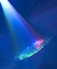 Fiber optics background with lots of light spots .