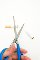 A hand cutting cigarette