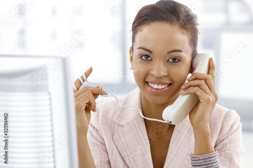 Ethnic businesswoman on landline call