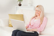 Young good looking woman relaxing with a laptop while sitting on