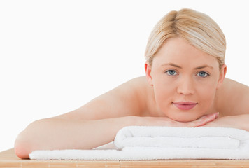 Young attractive blonde woman posing in a spa centre