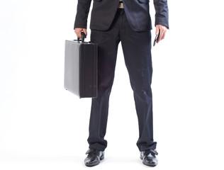 Hombre de negocios con maletín y móvil