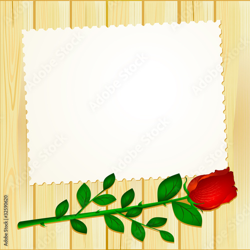 Card on wood with red rose
