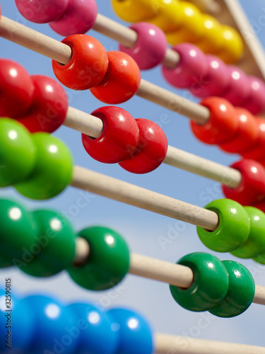 Close-up of a coloured children abacus in front of blue sky