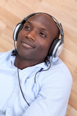 Relaxed man listening to music at home