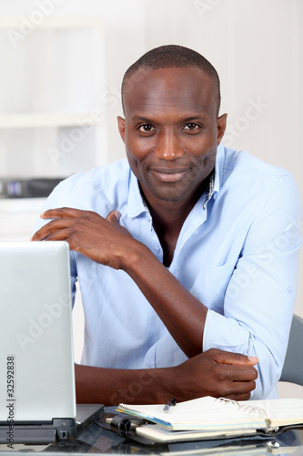Office worker working on laptop computer