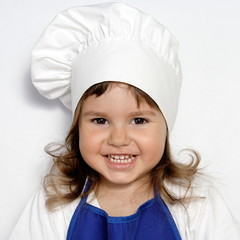 Little Cute Girl in Cook's Cap Portrait