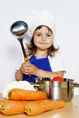 Smiling Girl in Cook's Cap Preparing Food