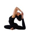 Yong woman sit in yoga asana - pigeon pose