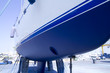 boat hull sailboat blue antifouling beached for paint - 32599432