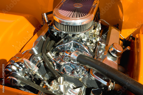 powerful vehicle engine with lots of chromed parts