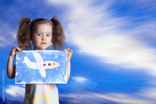 The child with the drawn plane against the sky