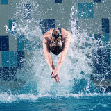 Swimmer jumping in swimming pool