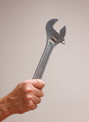 Man with spanner - in the works