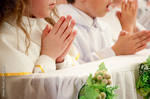 children accepting the first Holy Communion - 32612462