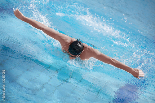 aerial view of swimmer performing  butterfly stroke