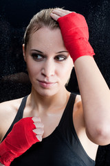 Portrait - Boxing training blond woman sparring