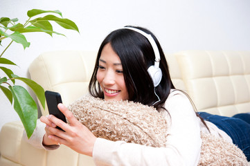beautiful asian woman listening to music