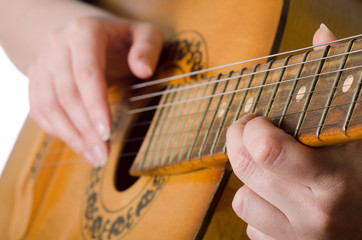 The woman plays an acoustic guitar