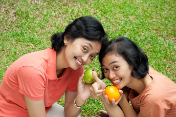 healthy asian women loves fresh fruit
