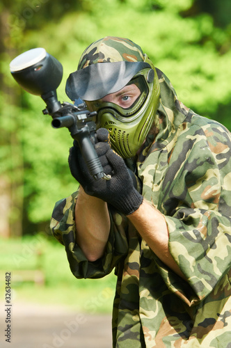 aiming paintball player