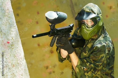 paintball player firing