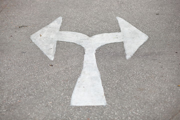white arrow on the road.