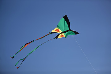 Close-up of a kite flying in the sky