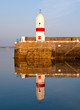 Old Lighthouse with Sea Water Reflection