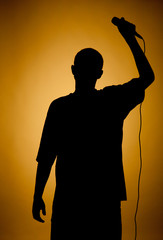 Silhouette of a young man in orange.