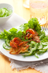 Potato rosti with smoked salmon and cucumber salad