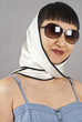 Asian Woman Wearing Sunglasses and Silk Scarf