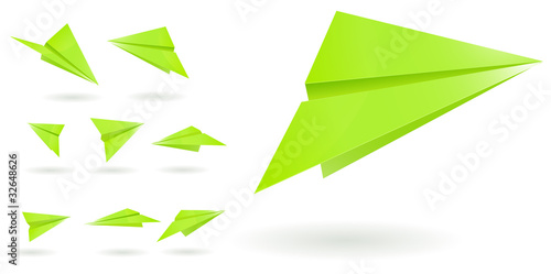 green paper planes isolated on white background