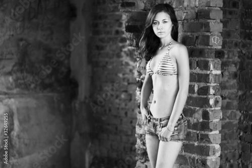 Young woman posing over old building