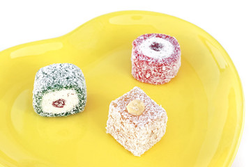 Turkish delight in a decorative yellow plate