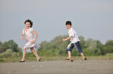 kids playing on beach