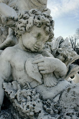 Detail of a cherub sculpture of Bacchus