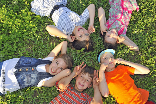 children laying together on ground