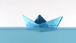 Blue paper boat on surfaces of water