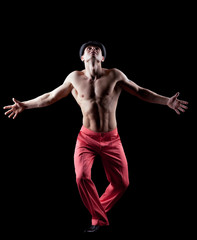 young naked man dance striptease in red costume