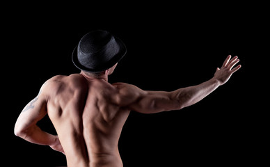 nude muscular athletic man pose in dark