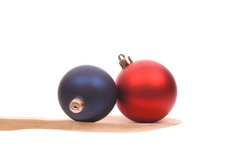 Christmasballs on a wooden spoon isolated on a white background