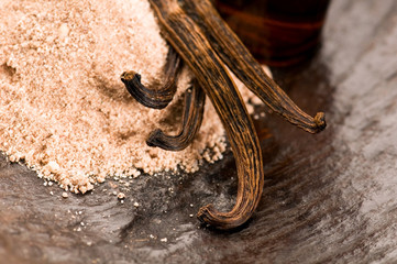 Vanilla With Bottle Of Essential Oil And Powder