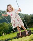 Happy childhood - swinging girl poster