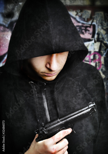 One young man with hand gun