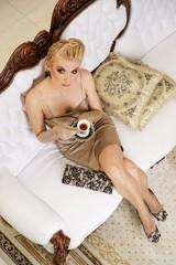 Beautiful woman drinking coffee in a luxury interior