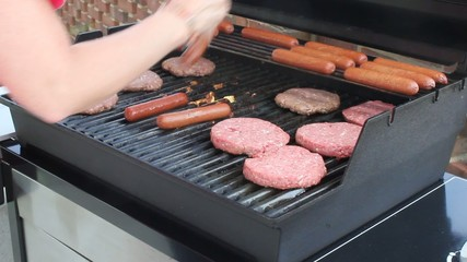 Burgers & Hot Dogs On A Grill