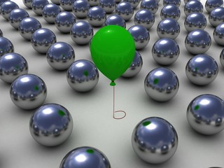 Green balloon among the shiny metallic balls