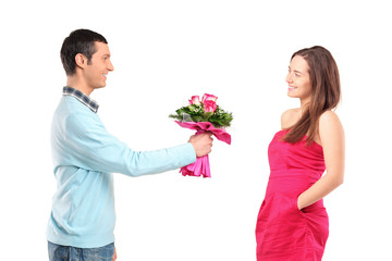 Boyfriend giving bunch of flowers to his girlfriend