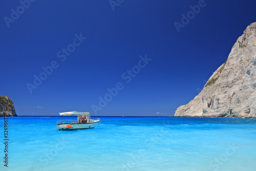 Boat anchored on Navagio beach, Zakynthos island, Greece